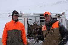 Dillon and Mike showing off the pheasants.
